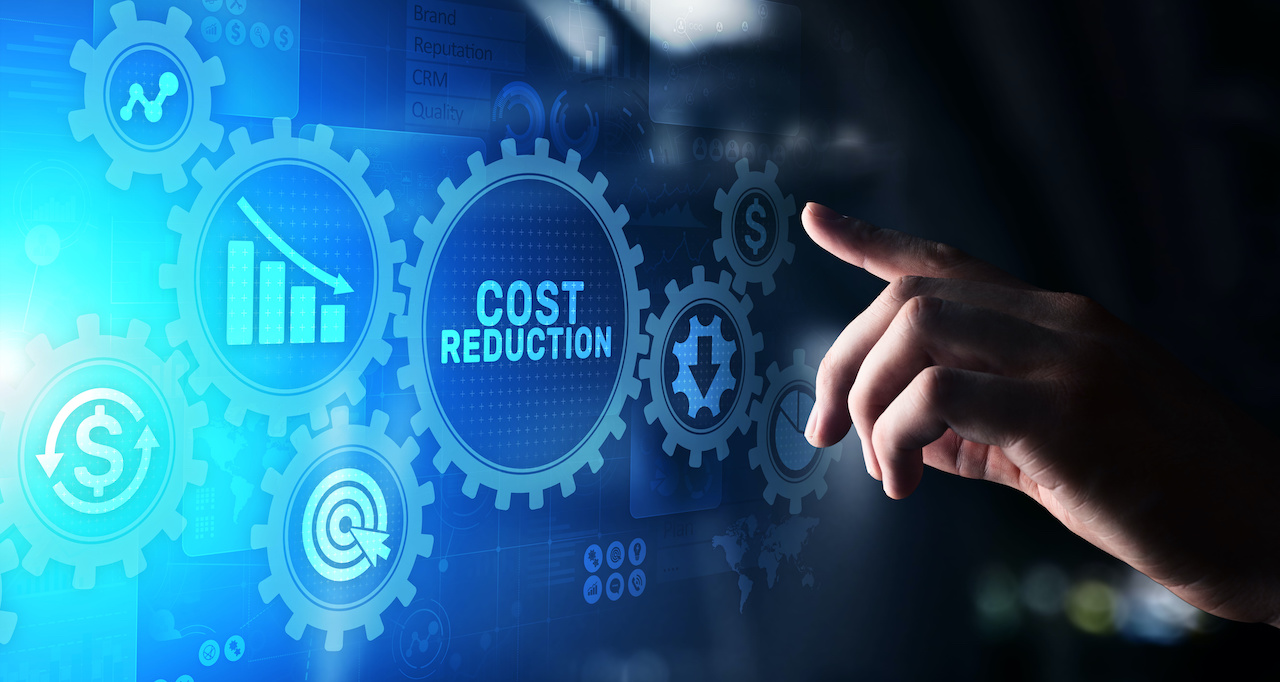 """hand selects a virtual gear tool titled """"cost reduction"""" on blue and black background"""